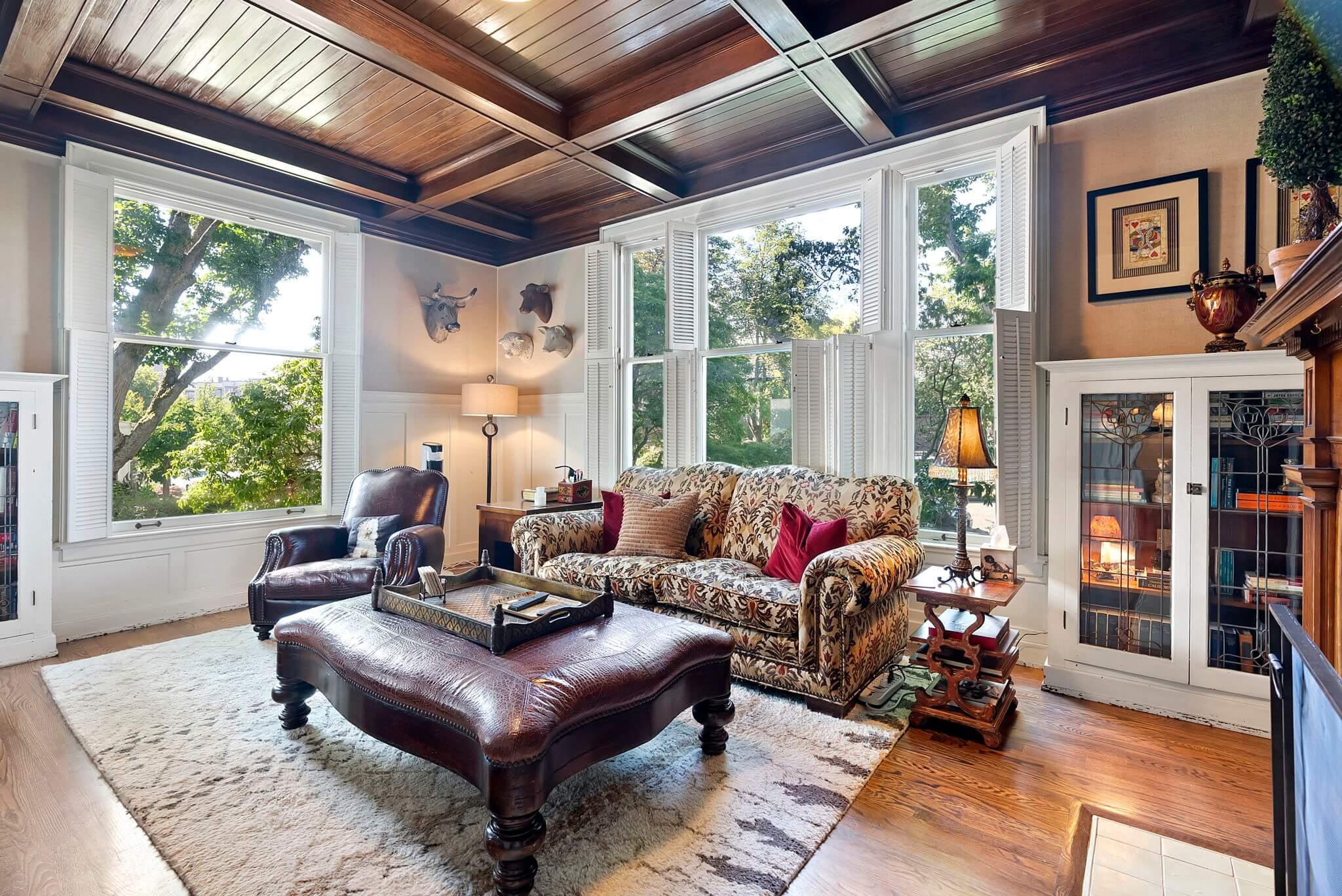 Main floor library with original box beam ceilings and leaded glass cabinets