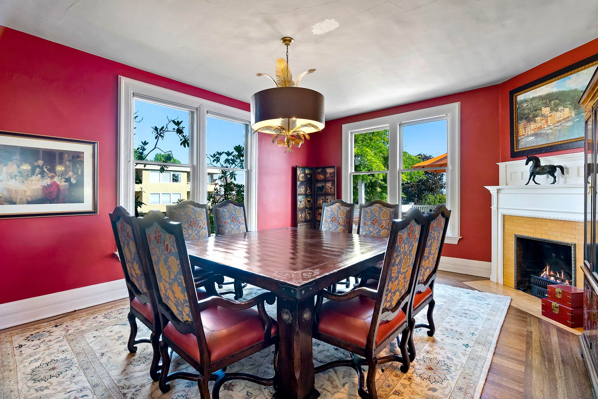 Spacious formal dining room with original fireplace