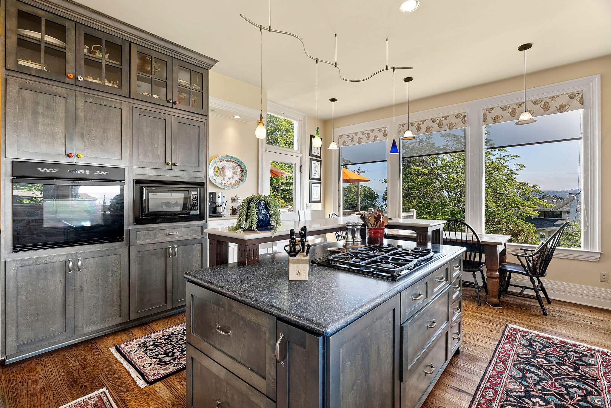 Kitchen features a central island and ample storage
