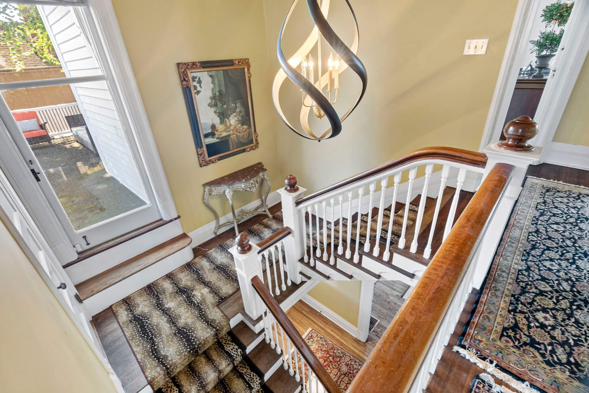 The formal staircase offers access to a roof-top deck over the porte-cochere