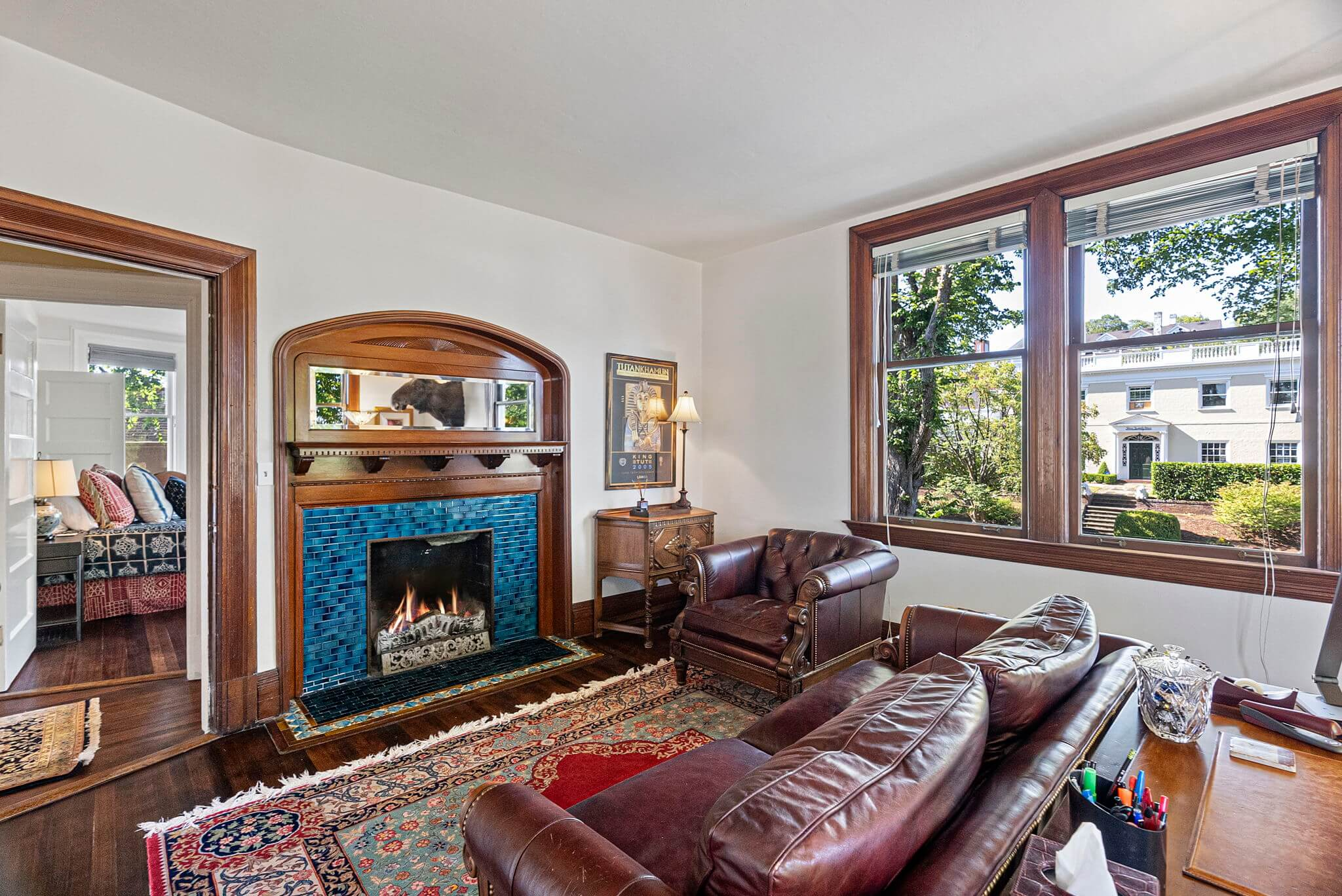 Bedroom #2 is currently used as an office and features a fireplace with original tile surround
