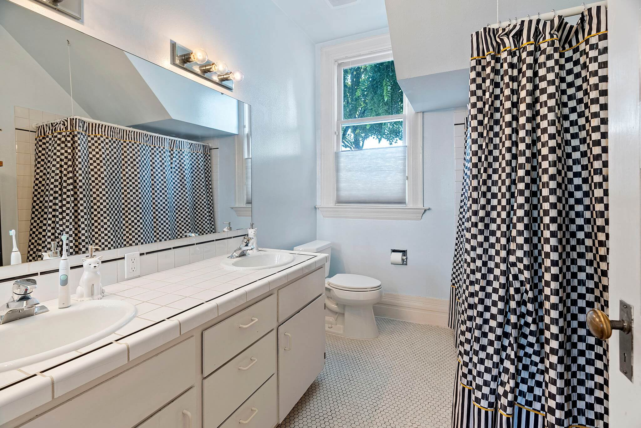 Second full bathroom with dual sink vanity off the hall on the second floor