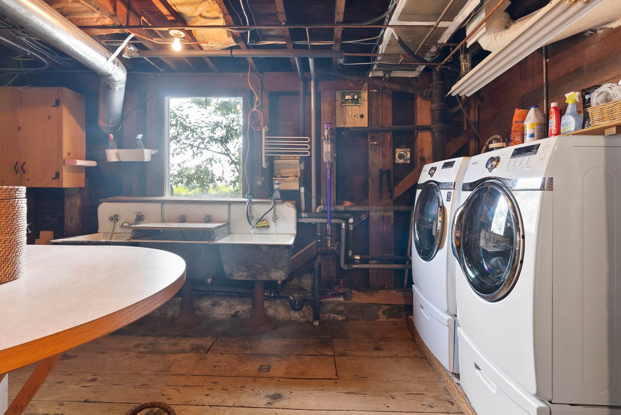 Large unfinished basement with ample storage and laundry