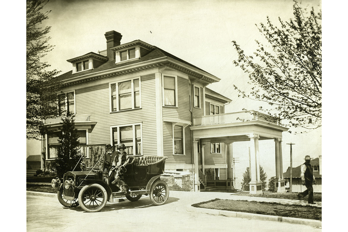 Charles and Franke with their dog driving onto D St circa 1915