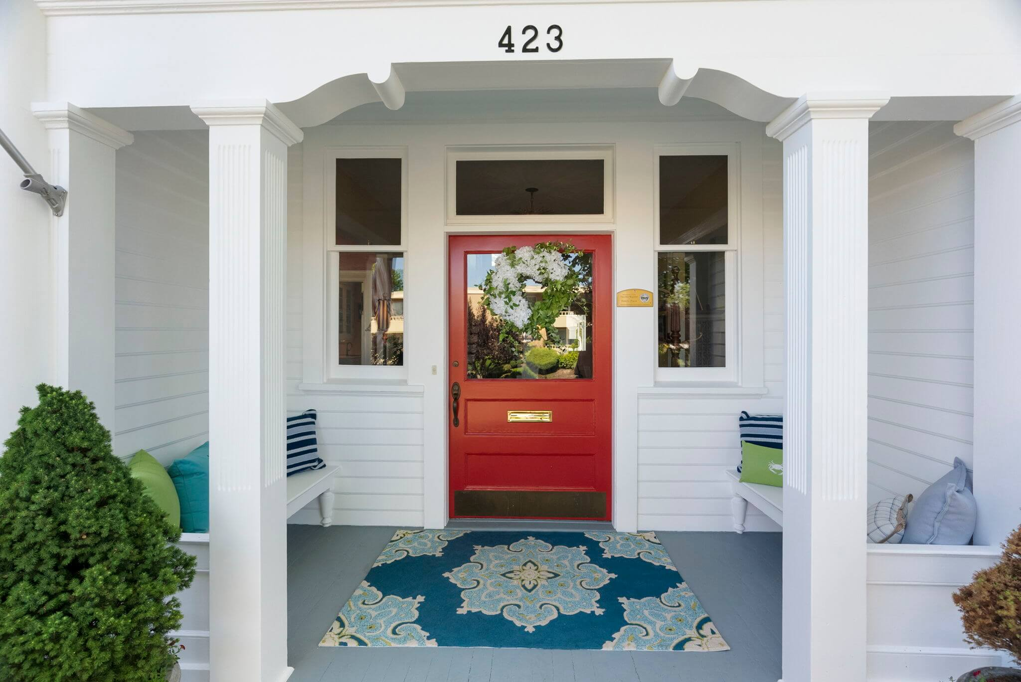 Covered front entry with built-in benches flanking the doorway
