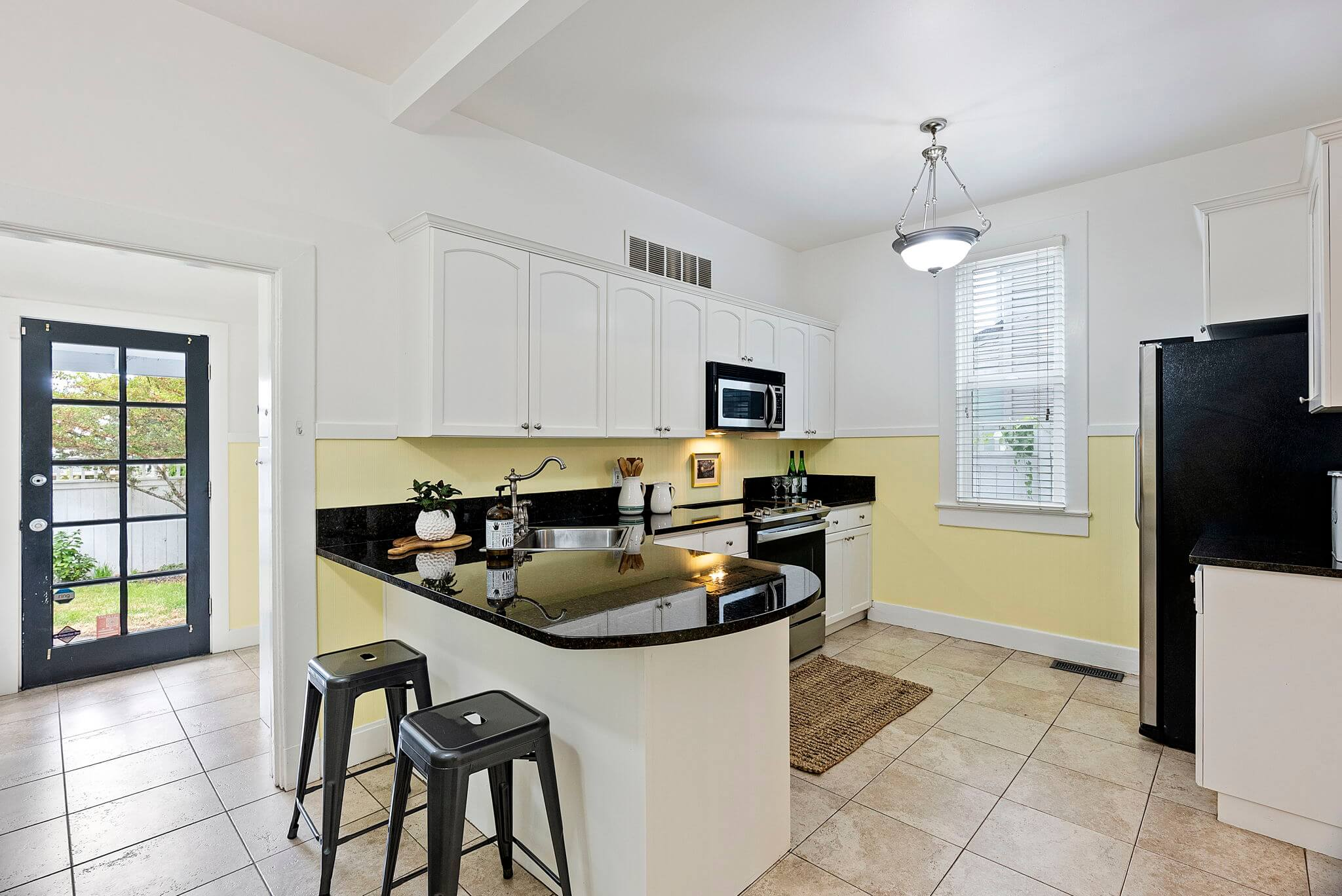 Updated eat-in kitchen with granite counters