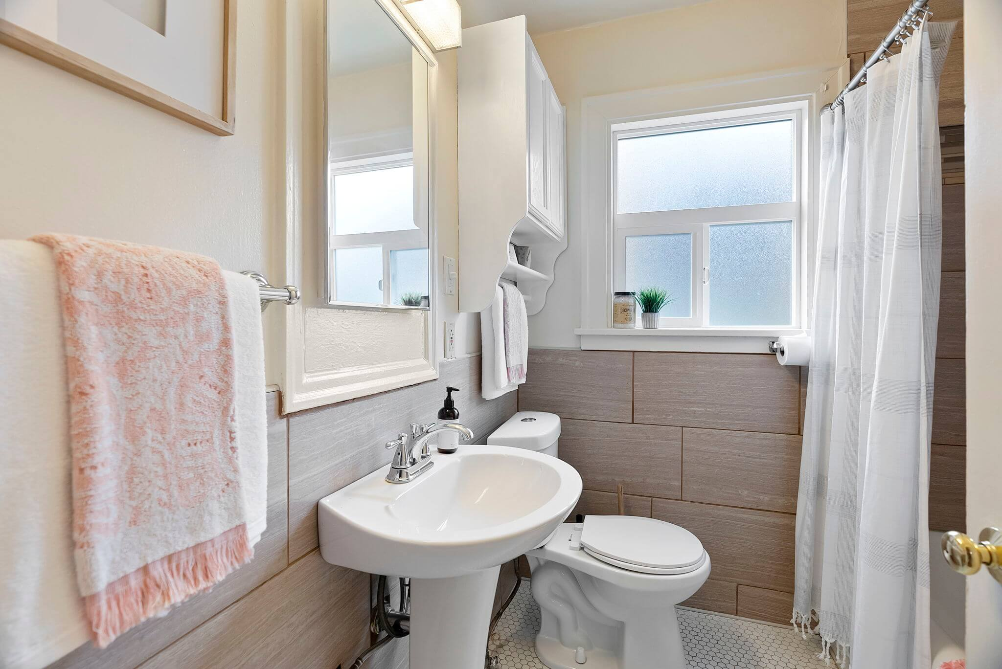 Full bathroom with tub/shower and pedestal sink