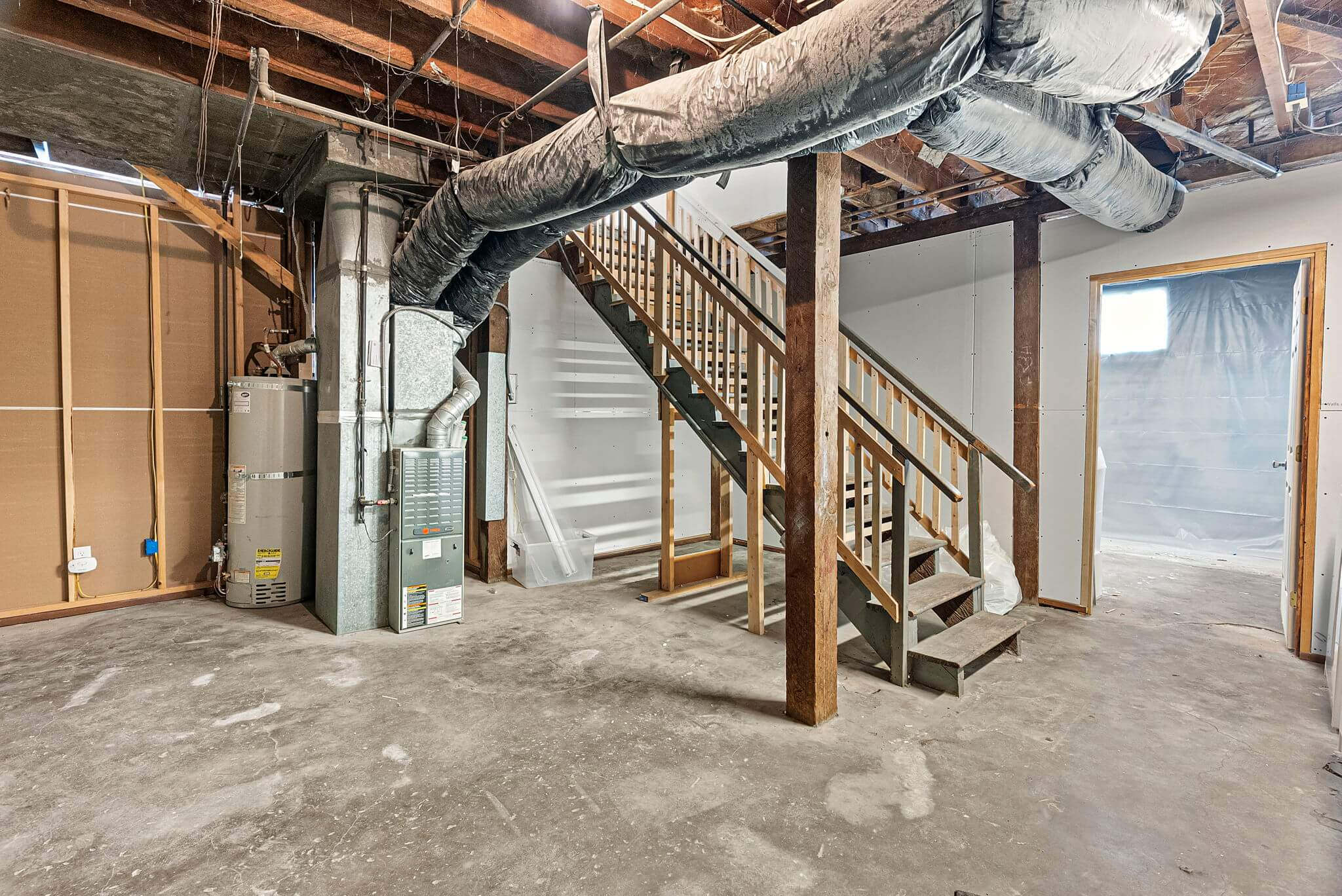 Unfinished basement with ample ceiling height