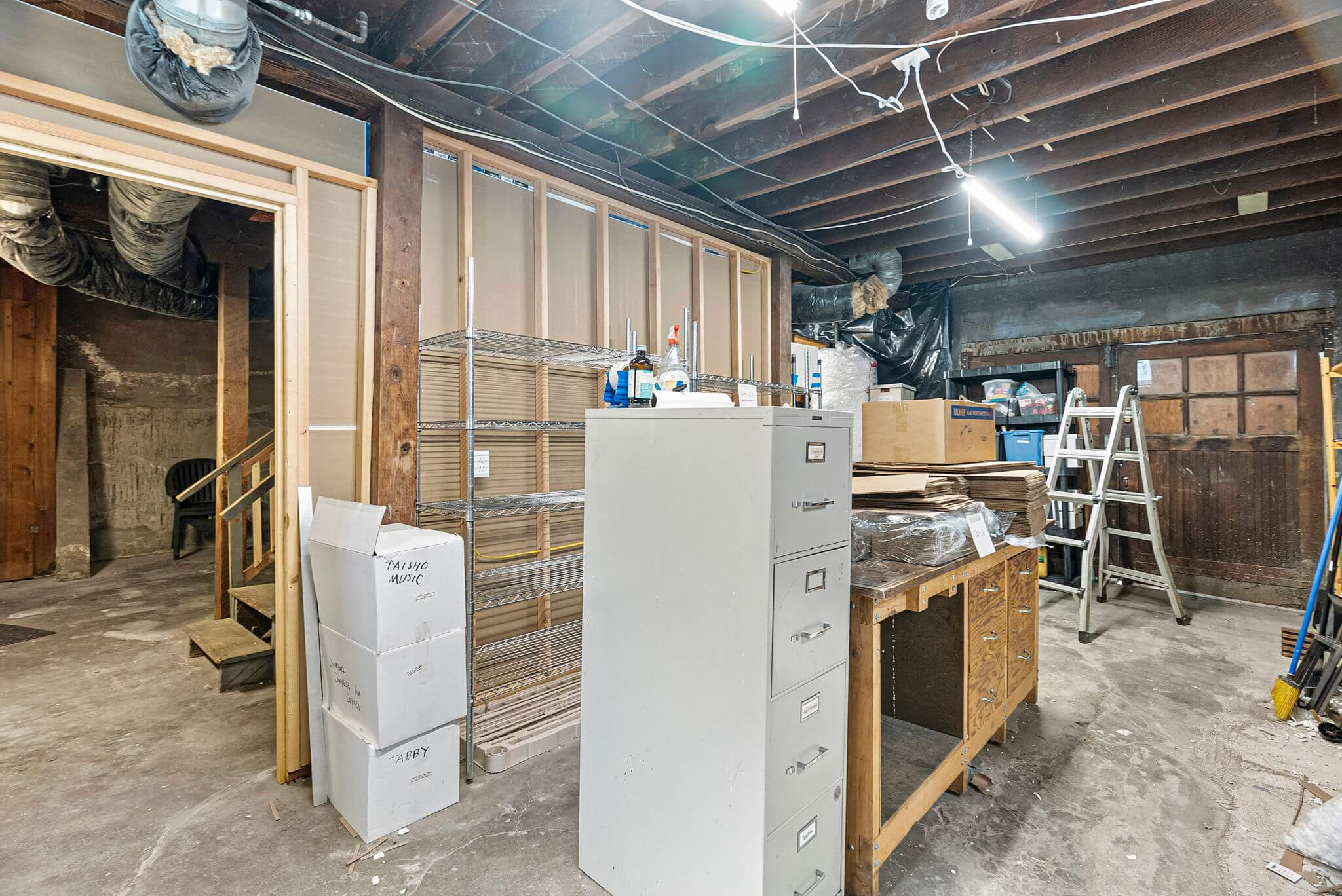 One car garage off the alley is currently used for storage