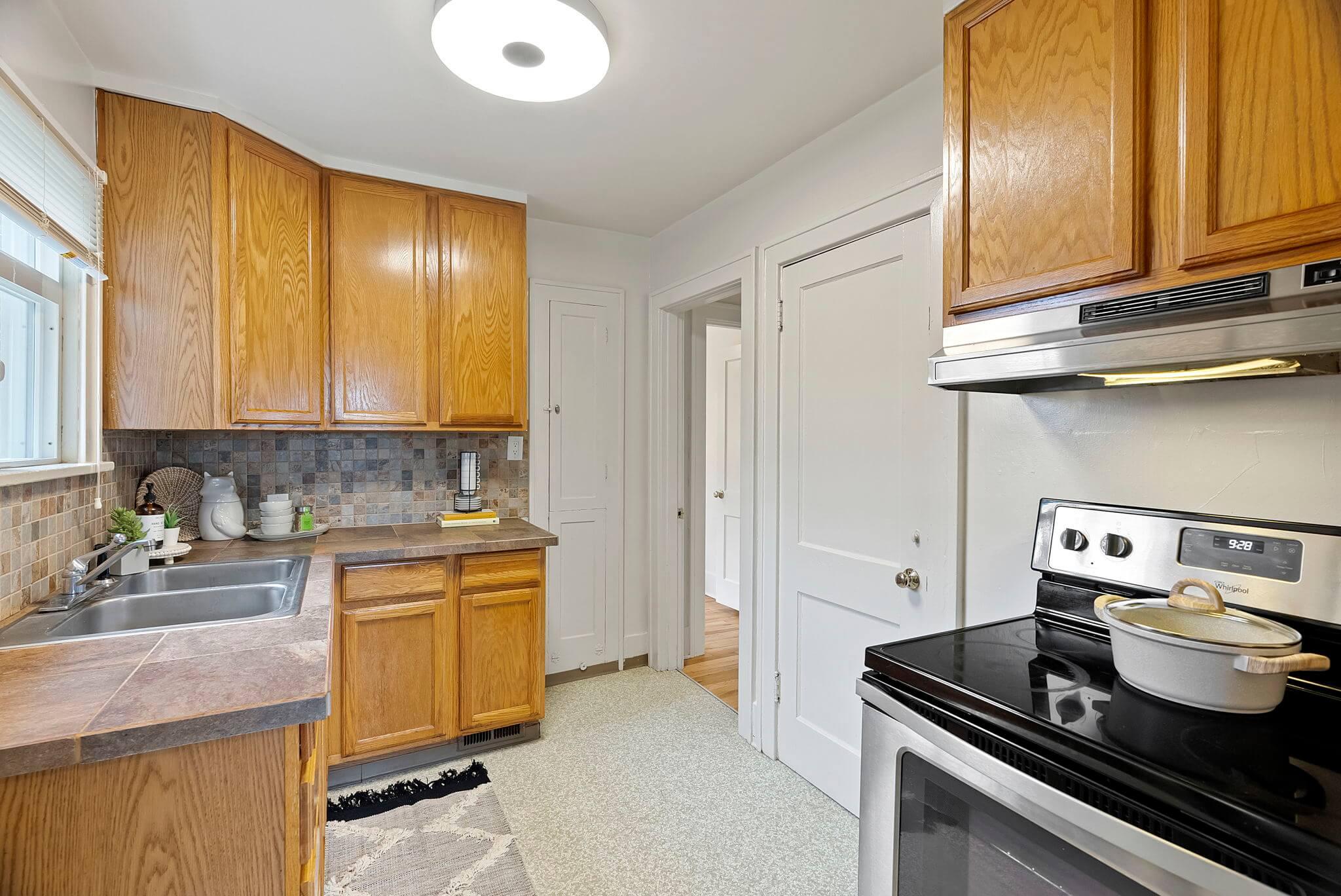 Closed kitchen door leads to basement