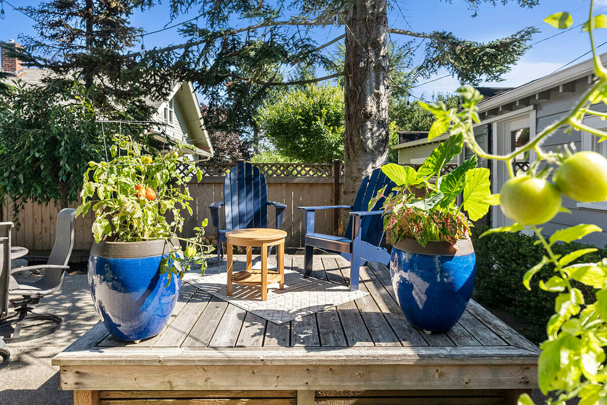 Peaceful back yard setting with raised deck