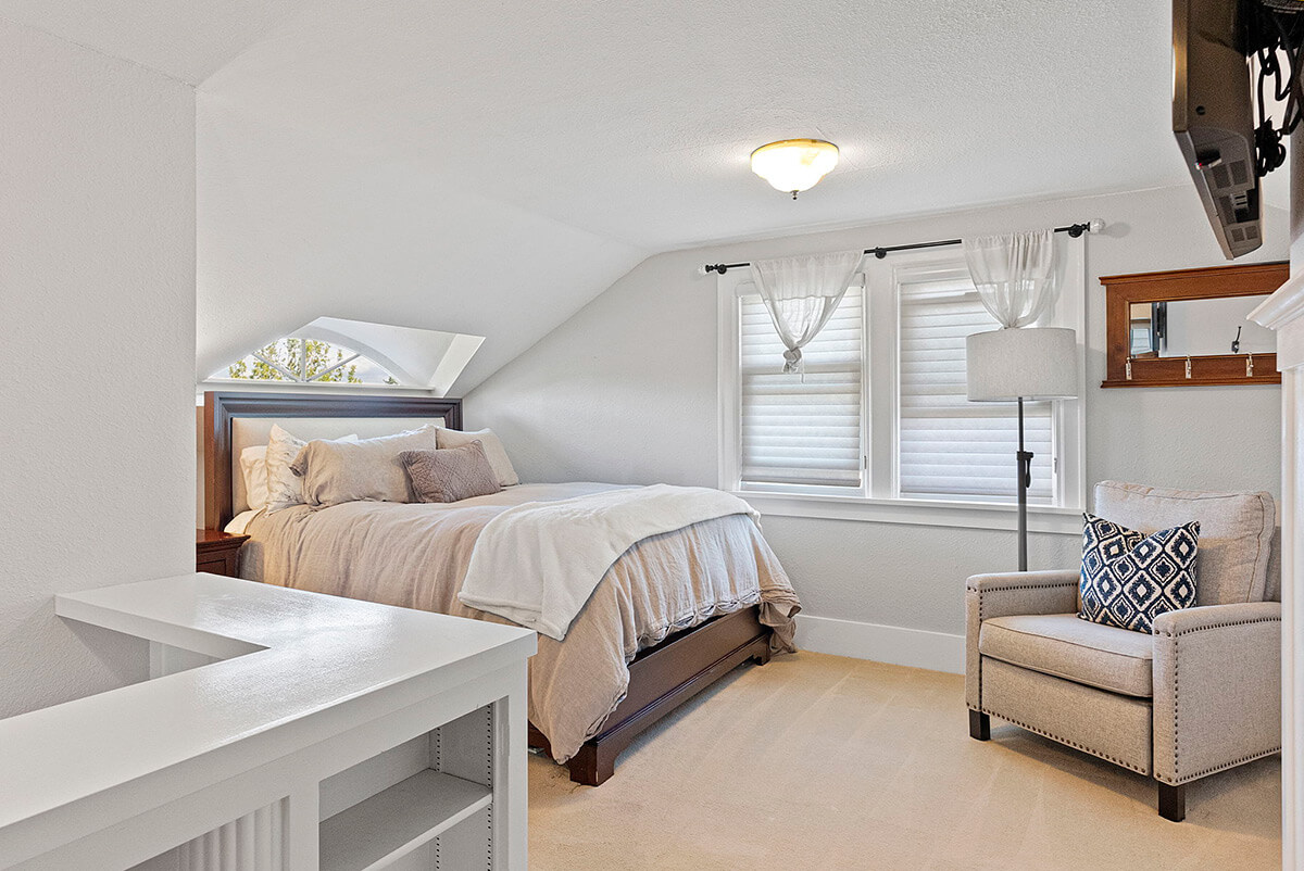 Upstairs primary bedroom with sitting area