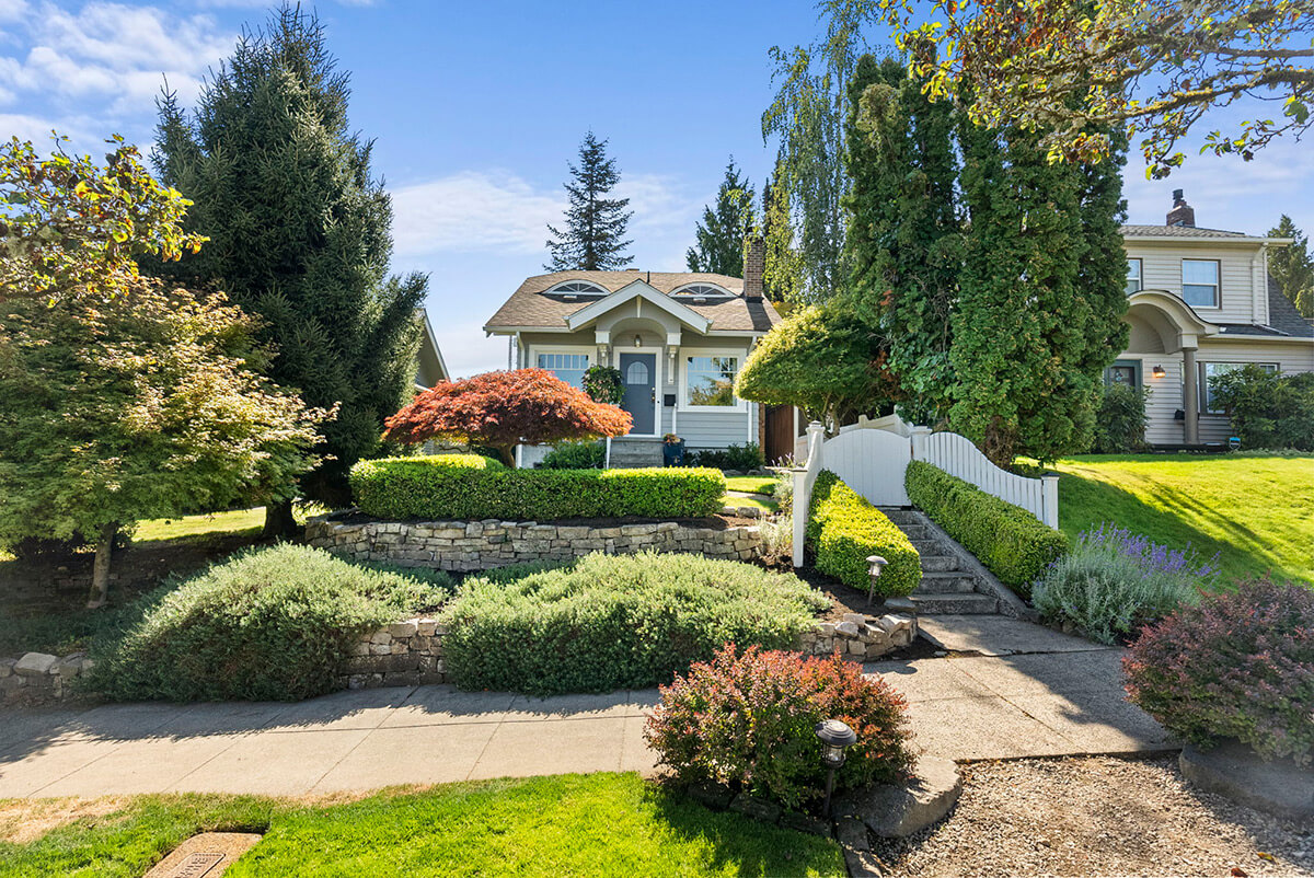 Beautifully landscaped front yard with a sprinkler system